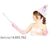 Купить «Девушка в колпаке на вечеринке с волшебной палочкой», фото № 4893762, снято 4 октября 2009 г. (c) Syda Productions / Фотобанк Лори