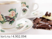 Чашка на блюдце и шоколад. Стоковое фото, фотограф Виктор Шилин / Фотобанк Лори