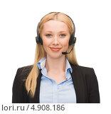 Купить «Успешная деловая женщина в черном костюме отвечает на телефонный звонок с помощью гарнитуры», фото № 4908186, снято 13 июня 2013 г. (c) Syda Productions / Фотобанк Лори