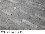 Купить «Серый плиточный тротуар», фото № 4911314, снято 10 июля 2013 г. (c) EugeneSergeev / Фотобанк Лори