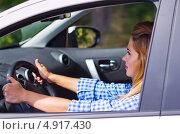 Купить «Женщина за рулем автомобиля», фото № 4917430, снято 6 июля 2013 г. (c) Ряпосов Борис / Фотобанк Лори