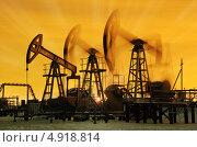 Купить «Нефтяные насосы-качалки на фоне закатного неба», фото № 4918814, снято 17 ноября 2012 г. (c) bashta / Фотобанк Лори