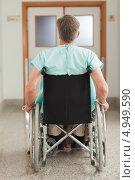 Купить «Вид со спины на мужчину в инвалидном кресле в больнице», фото № 4949590, снято 26 апреля 2012 г. (c) Wavebreak Media / Фотобанк Лори