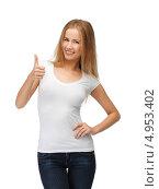 Купить «Веселая студентка в футболке и синих джинсах на белом фоне», фото № 4953402, снято 25 июня 2012 г. (c) Syda Productions / Фотобанк Лори