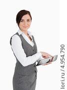 Купить «Привлекательная девушка в сером костюме касается экрана планшетного компьютера», фото № 4954790, снято 11 апреля 2012 г. (c) Wavebreak Media / Фотобанк Лори