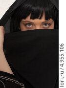 Купить «Девушка с тяжелым взглядом в черной парандже», фото № 4955106, снято 20 июля 2006 г. (c) Syda Productions / Фотобанк Лори