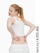 Купить «Девушка с болью в спине держит руки на пояснице», фото № 4955466, снято 5 апреля 2012 г. (c) Wavebreak Media / Фотобанк Лори