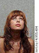 Купить «Рыжая девушка с челкой смотрит с надеждой вверх», фото № 4955494, снято 6 марта 2006 г. (c) Syda Productions / Фотобанк Лори