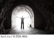 Купить «Человек стоит в темном туннеле со светом вдали», фото № 4958466, снято 28 июня 2013 г. (c) EugeneSergeev / Фотобанк Лори
