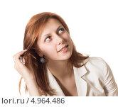 Молодая женщина смотрит вверх, изолированно на белом фоне. Стоковое фото, фотограф oleksandr gurin / Фотобанк Лори