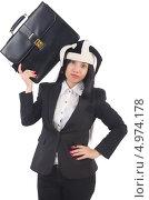 Усталая бизнес-леди в шутовском колпаке с дипломатом на голове. Стоковое фото, фотограф Elnur / Фотобанк Лори