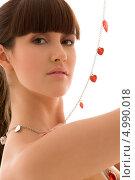 Купить «Молодая женщина на белом фоне с красными маленькими сердечками на гирлянде», фото № 4990018, снято 21 марта 2009 г. (c) Syda Productions / Фотобанк Лори