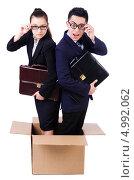 Купить «Пара деловых людей стоит в картонной коробке», фото № 4992062, снято 10 мая 2013 г. (c) Elnur / Фотобанк Лори