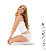 Купить «Красивая молодая женщина с волнистыми волосами в белом белье», фото № 5037970, снято 2 августа 2008 г. (c) Syda Productions / Фотобанк Лори