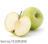 Купить «Одно целое зеленое яблоко и одна половинка», фото № 5039810, снято 12 марта 2012 г. (c) Natalja Stotika / Фотобанк Лори