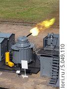 Купить «Стрельба из скорострельной шестиствольной корабельной пушки на военном полигоне», фото № 5049110, снято 3 июля 2013 г. (c) Игорь Долгов / Фотобанк Лори