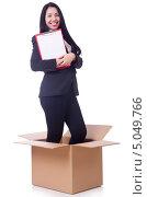 Купить «Деловая женщина с планшетом в руках стоит в картонной коробке на белом фоне», фото № 5049766, снято 8 мая 2013 г. (c) Elnur / Фотобанк Лори