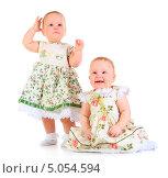Купить «Две годовалые девочки в нарядных платьях», фото № 5054594, снято 26 октября 2012 г. (c) Андрей Армягов / Фотобанк Лори