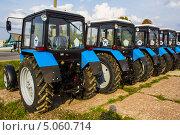 Купить «Новые тракторы», фото № 5060714, снято 18 сентября 2013 г. (c) Руслан Митин / Фотобанк Лори