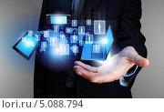 Купить «Современные компьютеры и планшеты в руках бизнесмена», фото № 5088794, снято 19 августа 2018 г. (c) Sergey Nivens / Фотобанк Лори