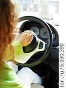 Купить «Девушка сидит за рулем автомобиля», фото № 5090390, снято 1 июля 2013 г. (c) Andrejs Pidjass / Фотобанк Лори
