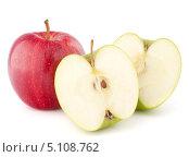 Купить «Одно красное яблоко и две половинки зеленого яблока», фото № 5108762, снято 13 марта 2012 г. (c) Natalja Stotika / Фотобанк Лори