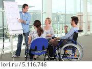Купить «Инвалид в кресле среди коллег в офисе», фото № 5116746, снято 15 июня 2010 г. (c) Phovoir Images / Фотобанк Лори