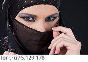 Купить «Девушка в черной парандже на лице», фото № 5129178, снято 1 июля 2008 г. (c) Syda Productions / Фотобанк Лори