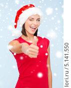 Купить «Счастливая молодая женщина в колпаке Санты и красном платье», фото № 5141550, снято 15 августа 2013 г. (c) Syda Productions / Фотобанк Лори