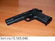 Пневматический пистолет UMAREX COLT 1911 A1 (2013 год). Редакционное фото, фотограф Чернышев Александр Анатольевич / Фотобанк Лори