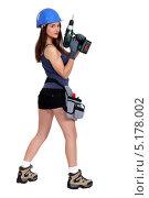 Купить «Молодая женщина в каске держит электродрель», фото № 5178002, снято 19 января 2011 г. (c) Phovoir Images / Фотобанк Лори