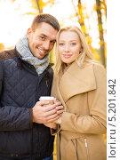 Купить «Романтичная пара в осеннем лесу солнечным днем», фото № 5201842, снято 5 октября 2013 г. (c) Syda Productions / Фотобанк Лори