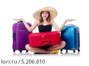 Девушка собирается в отпуск с чемоданами. Стоковое фото, фотограф Elnur / Фотобанк Лори