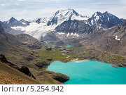 Озеро Ала-Куль в горах Тянь-Шаня. Стоковое фото, фотограф Евгений Дубинчук / Фотобанк Лори