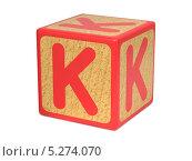 Купить «Буква K на детском деревянном кубике, на белом фоне», фото № 5274070, снято 7 ноября 2013 г. (c) Илья Урядников / Фотобанк Лори