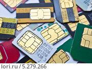 Купить «Сим-карты», фото № 5279266, снято 17 ноября 2013 г. (c) Sashenkov89 / Фотобанк Лори