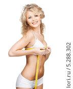 Купить «Стройная красивая женщина в скромном белье измеряет объемы тела сантиметром», фото № 5288302, снято 21 ноября 2009 г. (c) Syda Productions / Фотобанк Лори