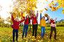 Дети подбрасывают осенние листья, фото № 5308778, снято 6 октября 2013 г. (c) Сергей Новиков / Фотобанк Лори