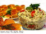 Салат Оливье, бутерброды с красной икрой и красная рыба на праздничном столе, на белом фоне. Стоковое фото, фотограф Лукманов Виталий / Фотобанк Лори