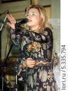 Купить «Певица Пелагея (Ханова Пелагея Сергеевна)», эксклюзивное фото № 5335794, снято 8 ноября 2013 г. (c) Андрей Дегтярёв / Фотобанк Лори