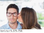 Купить «Attractive designer giving a kiss to a colleague», фото № 5375758, снято 20 марта 2013 г. (c) Wavebreak Media / Фотобанк Лори