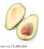 Две половинки спелого авокадо, изолированно на белом фоне. Стоковое фото, фотограф Natalja Stotika / Фотобанк Лори