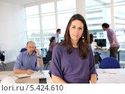 Купить «Привлекательная девушка в офисе на фоне коллег», фото № 5424610, снято 20 января 2010 г. (c) Phovoir Images / Фотобанк Лори