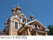 Купить «Деревянные купола на фоне синего неба», фото № 5433954, снято 3 июля 2013 г. (c) Петрова Ольга / Фотобанк Лори