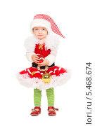 Купить «Девочка в костюме гнома держит в руках новогодние шарики», фото № 5468674, снято 8 ноября 2013 г. (c) Сергей Сухоруков / Фотобанк Лори