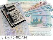 Купить «Калькулятор, ручка, паспорт транспортного средства, полис на белом фоне», фото № 5482434, снято 12 января 2014 г. (c) Алексей Карпов / Фотобанк Лори