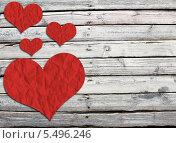 Купить «Бумажные красные сердечки на деревянной поверхности», иллюстрация № 5496246 (c) Кирилл Черезов / Фотобанк Лори