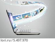 Купить «ноутбук с видеокадрами», фото № 5497970, снято 14 ноября 2013 г. (c) Syda Productions / Фотобанк Лори