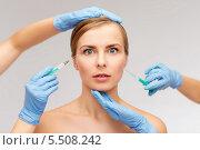 Купить «Испуганное лицо девушки и руки косметологов со шприцами», фото № 5508242, снято 5 декабря 2013 г. (c) Syda Productions / Фотобанк Лори