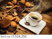 Купить «Натюрморт с чашкой кофе, кофейными зернами и специями на деревянном столе», фото № 5524250, снято 21 января 2014 г. (c) Andrejs Pidjass / Фотобанк Лори